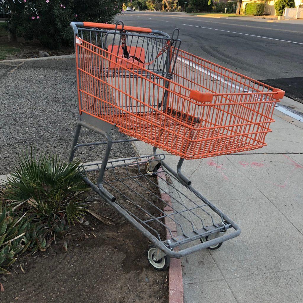 abandoned orange shopping cart
